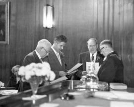 [Mayor Fred J. Hume swearing Alderman George C. Miller, Thomas F. Orr and Halford D. Wilson into ...