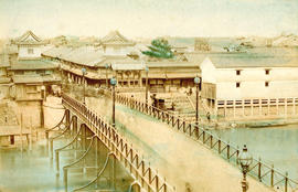 [View of bridge leading to pagodas]