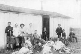 [Lacrosse players relax in front of Al Larwill's shack on the Cambie Street Grounds]