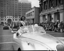 Car carrying Miss Sports [Day?] in 1953 P.N.E. Opening Day Parade