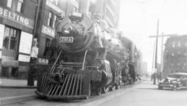 [C.P.R. locomotive No. 2614 crossing Alexander Street]