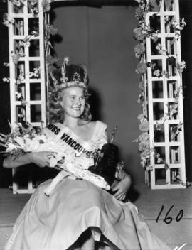 Winner of Miss Vancouver 1955 posing with flowers
