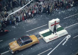 43rd Grey Cup Parade, on Granville Street Rover Scouts float and car, ticker tape, and spectators