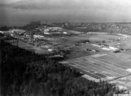 [Aerial photograph of University of British Columbia Endowment Land area, showing some farm land]