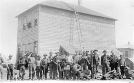 [Men assembled in front of Victoria Hotel at 792 Westminster Avenue (Main Street)]