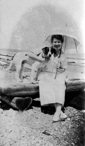 Eva Godfrey with Roy Pearson's dog (Keno) at Boundary Bay