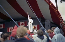 Unidentified man wearing white robe on stage at Canada Day celebration
