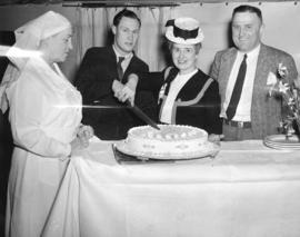 [Harold J. Christison and Margaret McNeil poised to cut a diamond jubilee cake]