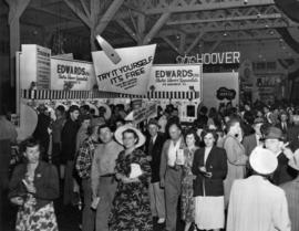 Edwards display of electric shavers, crowd in the Manufacturer's building