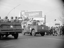 [Trucks carrying soldiers in a military parade along Burrard Street]