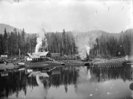 [Fraser Valley Sawmill, with water and shore area in foreground, and forest in background]