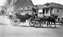 [Horse drawn carriage at Georgia Street and Homer Street]