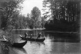 [First Nations men in canoe on the Skeena River]
