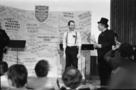 Unidentified man and Harry Rankin deliver theatrical presentation