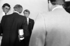 Michael Francis and Brian Mulroney speaking to two unidentified men