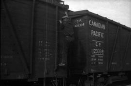 Man climbing onto freight car