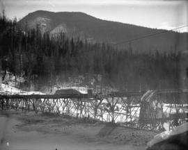 [Coquitlam dam site covered in snow, showing flume and settling pond]