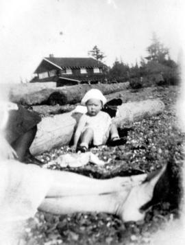 [Small child sitting on beach at Summit Lake]