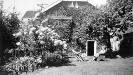 [Eileen Marsack and Emily Matthews in the garden at 1158 Arbutus Street]