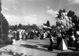 Balloon vendor and sales booths on P.N.E. grounds