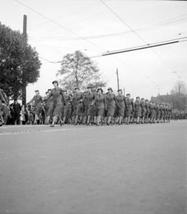[Women in uniform marching in a military parade along Burrard Street]