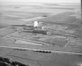 Air view of factory site, looking northwest
