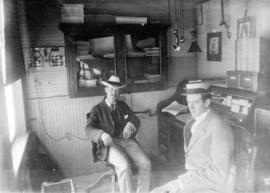 Edward Burchell and unidentified man in unidentified office