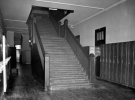 Interior of Fairview High School of Commerce, stairway and lockers