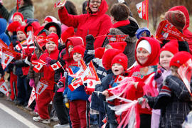 Day 19 Crowd of children cheer on the flame as it passes in Nova Scotia