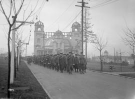 [Soldiers marching in front of Women's Building]