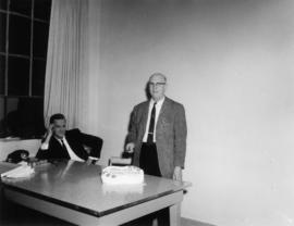 Wilfred Kenyon, Superintendent, Retiring; cutting cake in No. 1 lab with W. Murdoch (seated)