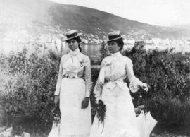 "Miss Kate Rockwell ""Klondike Kate"" and Miss Lilly Edgerton on the bank of the Yukon River"