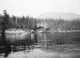 "[View from the water of ""The Pilotage"" and boathouse near Skunk Cove]"