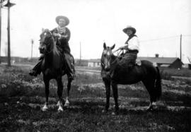 [Mayor L.D. Taylor on horseback with former Edmonton mayor Kenneth Blatchford]