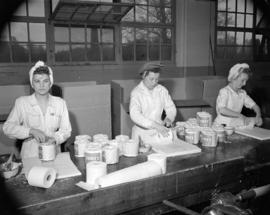 [Women packaging rolls of Purex tissue at Westminster Paper]