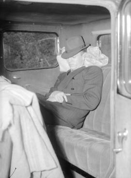 [A man taking a nap in a car during visit of King George VI and Queen Elizabeth]