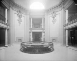 [The interior of the courthouse rotunda under the dome]