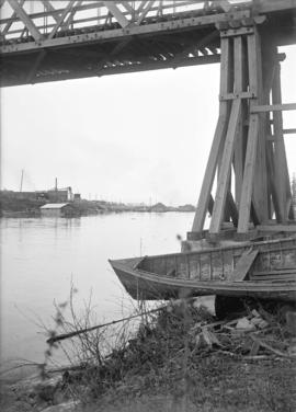 [View of buildings and bridge on the Fraser River]