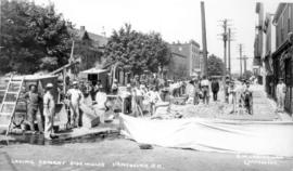 G.W. Ledingham, Contractor Laying Cement Sidewalks [in the 500 and 600 Blocks of Georgia Street]