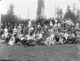 [Men, women and children assembled for Good Templers picnic near Tom Turner's orchard]