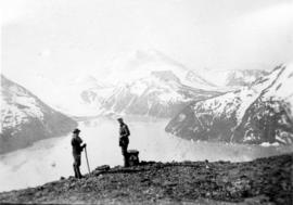 [Two hikers on the shore of Garibaldi Lake]