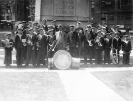 [Group portrait of Mayor L.D. Taylor with members of the Victoria Navy League Band in front of ce...