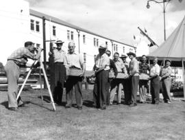 1952 Lions Exh. : [men posing with beam of wood]