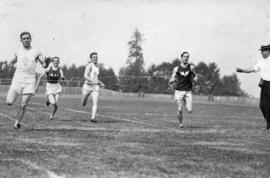 [Men race towards the finish line at an N.P.A.A.W. sports meet at Brockton Point]