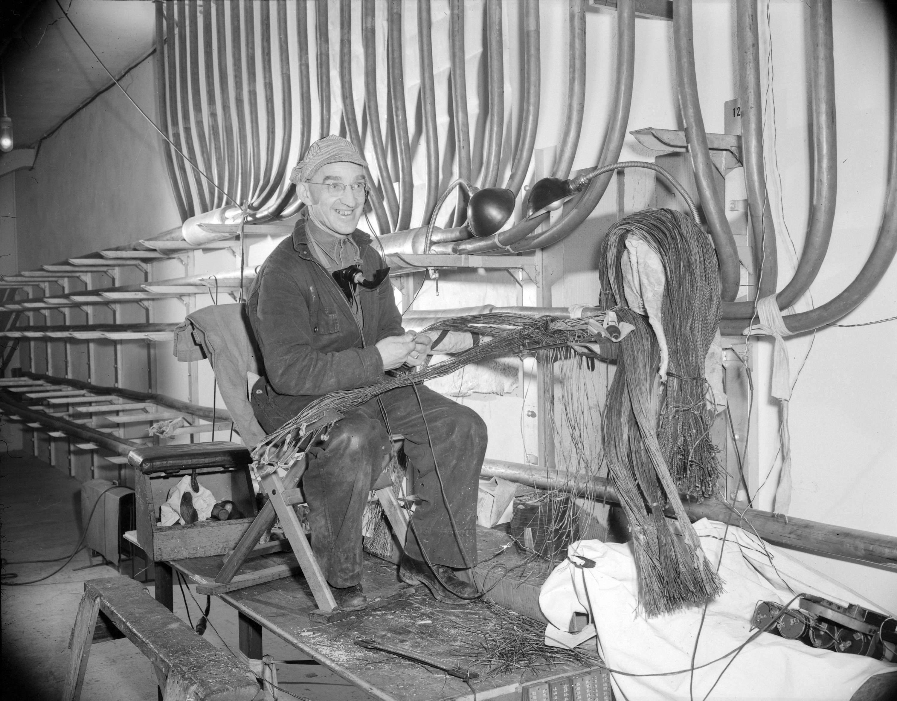 B.C. Telephone technician wiring circuits for the new telephone ...