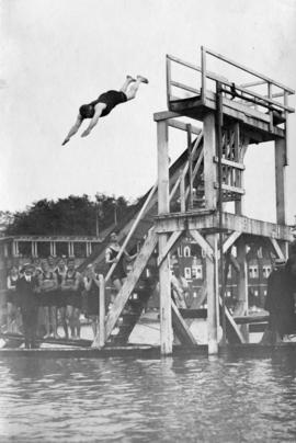 [Man diving off the slide platform at English Bay]