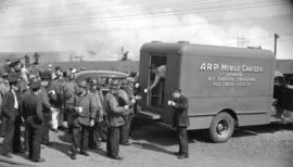 [A.R.P. mobile canteen at the scene of a fire]