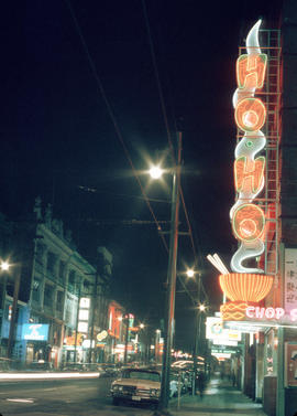 [View of East Pender Street at night]