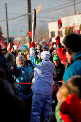 Day 90 Torchbearer 33 Roy Sakaki runs the flame in to Salmon Arm's Community Celebration in ...