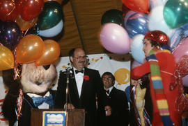 Tillicum, Mike Harcourt, Michael Francis and man in costume on stage at Vancouver's 99th birthday...